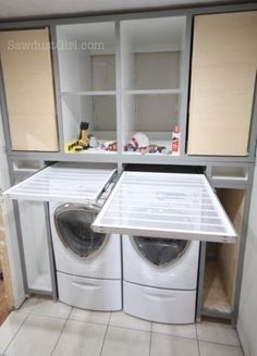 Laundry room ideas -- I love the location of the flat-dry drawers above the washer and dryer