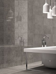 Archistone Graphite for bathroom floors and feature walls. The damascato for the foyer entrance