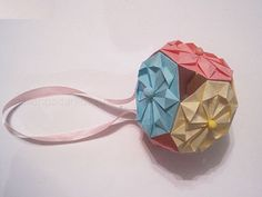 Art of folding pieces of paper called Origami. Kusudama - a three-dimensional crafts balls of paper, consisting of the same elements - modules still have the name of a modular origami This Kusudama you can perform in any color and present in addition to the main gift.