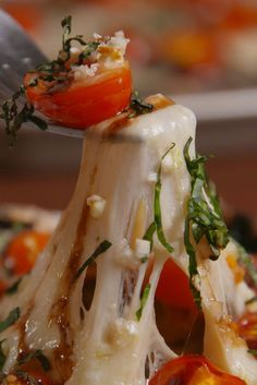 A new spin on a classic flavor combination.  Get the recipe from Delish.#MsD~ Can stuff cherrt tomatoes w/ pearl mozz balls instead of on top. Toss w/ Pesto