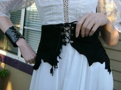 Corset belt  https://www.etsy.com/listing/74568965/custom-made-black-suede-leather-corset