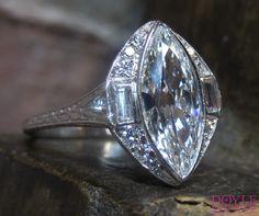 Unique Art Deco marquise diamond engagement ring, from Doyle & Doyle.