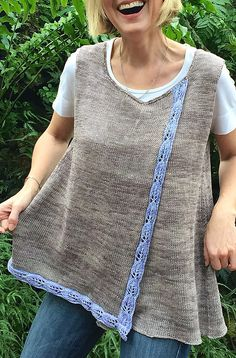 Free Knitting Pattern for Bay Laurel Tunic - This flattering sleeveless tank top is knit flat in two pieces and features overlapping construction and a leaf lace border. Great for layering. Designed by Julie Turjoman. XS [S, M, L, 1X, 2X, 3X]