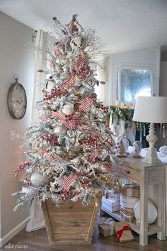 Christmas Tree & Family Room Nastalgic Christmas Tree in DIY Box stand with red striped Ribbon, rustic bells, and Mercury glass ornaments.Nastalgic Christmas Tree in DIY Box stand with red striped Ribbon, rustic bells, and Mercury glass ornaments. Silver Christmas Decorations, Christmas Tree Themes, Noel Christmas, Simple Christmas, Rustic Christmas Tree Decorations, Christmas Ribbon, Elegant Christmas, Flocked Christmas Trees Decorated, Christmas Ideas