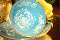 Beautiful Aqua/Turquoise Aynsley White Rose Footed Tea cup and Saucer, England