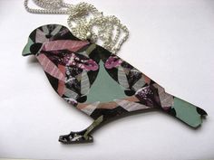 Beautiful patterned laser cut bird necklace by MicaPeet on Etsy, £15.00