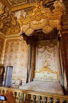 Palace of Versailles: Queen's bed. The little door was used by Marie-Antoinette when rioters invaded the palace.