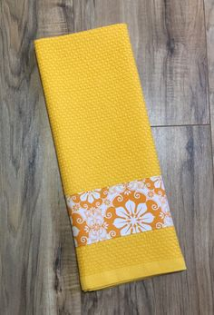 A personal favorite from my Etsy shop https://www.etsy.com/listing/473874398/golden-yellow-flower-kitchen-towel