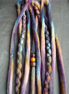 Removable Wool Tie-dye dreads by Purple Finch! Set of 10 total Hair Extensions  Set includes: 8 wool Tie-dyed dreadlocks 2 wool Tie-dyed x-cross wraps 3 small wooden bead 1 silver tone bead