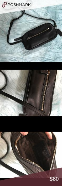 "Coach Legacy Black leather camera bag Top zipper closure Front zipper pocket Coach black leather hangtag Black leather strap 22"" Silver hardware Interior brown logo santeen fabric Serial#9589 Coach Handbag Measurements:  9"" L x 4"" H x 2"" D  Condition of Handbag: Fabric of bag no stains, marks, etc Interior clean no stains, rips, etc. Coach Bags Travel Bags"