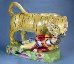 Another violent figurine showed the death of Lt. Hugh Munro, who was attacked by a tiger while hunting in India. The figure was modeled after a life-size automaton created for a Sultan of Mysore, ostensibly celebrating India's defeat of the British. Photos © Myrna Schkolne 2013.