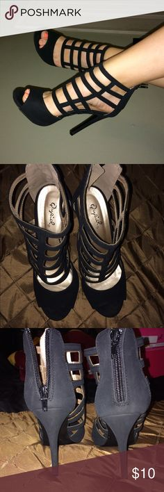 Caged Heels These go perfect with any dress that needs a little extra something, or a pair of pants for Sunday brunch  They fit more like a seven. small scratch in right heel as pictured, other then that they're very well taken care of. Price reflects damage. Qupid Shoes Heels