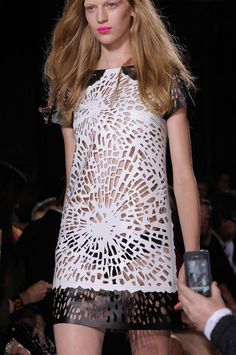Laser Cut Fashion - laser cut leather dress with scattered floral burst pattern in bold black & white - fashion details // Giles