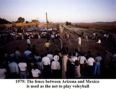 """""""1979: The fence between Arizona and Mexico is used as the net to play volleyball"""" — at Arizona."""