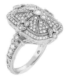 Estate White Gold Cushion RingEstate inspired ring with pave diamonds in 18k white gold. 1.52 carats