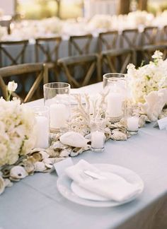 40 amazing beach wedding centerpieces weddingomania once upon a beach table decorations featuring white flowers candles coral and oysters so perfect for an oyster or clam bake reception junglespirit Gallery