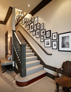 Love the look of this wall collage...we have one going up our stairs but I love the look of the matted frames in this one.