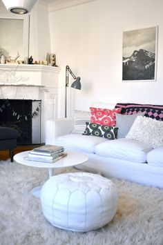 flokatis are always a fav....and then the print pillows on the white sofa...love. sfgirlbybay...Victoria, such style!
