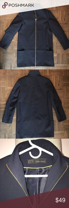 """Zara Spring Funnel Neck Coat Gently worn but in great condition! Contrast gold zipper makes this navy spring weight coat the perfect transition piece. Funnel neck with full zip. Low slung pocket as pictured. Fully lined. Falls 32"""" from high point shoulder. Zara Jackets & Coats"""