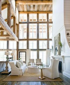 Talk about high ceilings! So awe inspiring! Love the reclaimed wood beams and incredible windows!