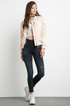 A pair of denim woven skinny jeans with a high-waisted fit, exposed button fly, and a five-pocket construction.