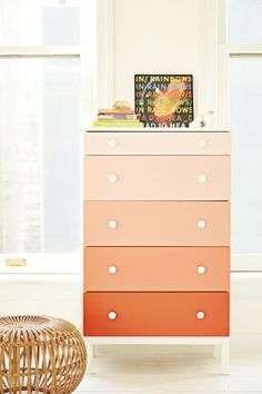 Adios, boooring dresser! Go for an unexpected ombré effect by painting each drawer a different shade of the same color.