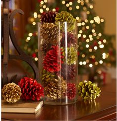 JoAnn Fabrics Holiday 2012 Good tidings with a twist!  Update pine cones with splashes of color. Paint pine cones red, gold, burgundy and green then brush clear glitter on each one. Showcase them in a simple glass container for all to admire