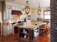 This Red stove and hood looks great with these Huggy Bear White Cabinets with a Brown Glaze