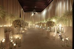 """This is a bit much. But, if ceremony and reception were in using the same space: Section front for entry (changed to cocktail hour after ceremony), walking tunnel to ceremony area (sides hiding prepped reception tables to be reconfigured directly after ceremony during cocktail """"hour"""" in reception. """"Alter"""" to stage/dance floor. Tada."""