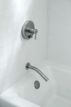 Brushed nickel hardware lend a sleek and streamlined style to the bathtub and shower duo.