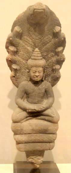 Image from http://upload.wikimedia.org/wikipedia/commons/7/72/Muchilinda_Buddha_from_Thailand,_Angkor_kingdom,_Lopburi_style,_13th-14th_century,_sandstone,_promised_gift_to_HAA.JPG.