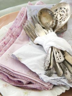 """When you're not hosting parties or entertaining, use antique tarnished silverware to add decorative detail to your """"display-only"""" table settings. Wrap and tie a handkerchief around a bundle of silverware to give your table even more shabby chic-ness. Design and photography by Lulu Tapp of DustyLu Interiors. Room accessories and decor from Rachel Ashwell Shabby Chic Couture"""