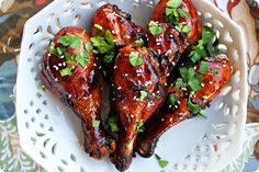"""Sweet 'n' Sticky Baked Chicken Drumsticks - I got a great deal on drumsticks last week and found this recipe.  Oh. My. Word.  So yummy!  """"Grilling"""" the chicken in the oven made the skin crisp and the inside still so juicy. K declared it the best chicken she'd ever had."""