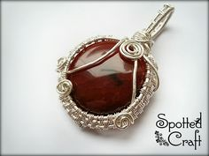 A beautiful dragon veins agate pendant wrapped in silver plated wire. #spottedcraft