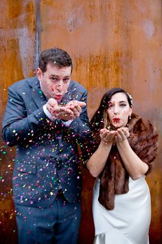 Playful confetti wedding portrait in front of the Wythe Hotel in Williamsburg, Brooklyn. Photographed by Steadfast Studio.