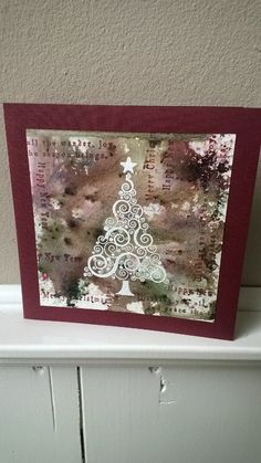 ink on craft sheet mixed with a little bister, then tree heat embossed in white