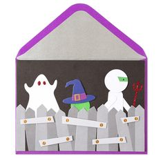 A mummy, a witch and ghost go trick-or-treating in the neighborhood scene of this fun halloween card handmade with tip-ons and glitter. | Price $6.95