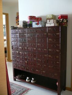 Little Medicine Cabinet For Supplies............A whole board of wonderful little cabinet with teeny little drawers.............I want them all! ................The board is Case Study By Anat Dart.