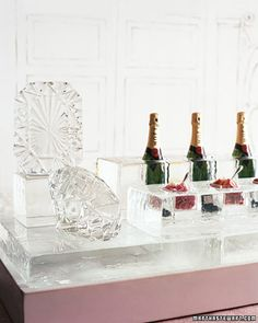 Diamond Ice Bar | Giant diamonds, chiseled by an ice sculptor, were set on a massive carved ice bar at this New York wedding. Frozen coolers held Champagne, while rose petals and strawberry slices rested in square dishes of clear acrylic.
