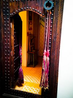 Moroccan door, vintage Moroccan tassels, and patterned Moroccan tile at Peacock Pavilions design hotel in #Marrakech #Morocco.  Moroccan design, Moroccan style, #tribalchic