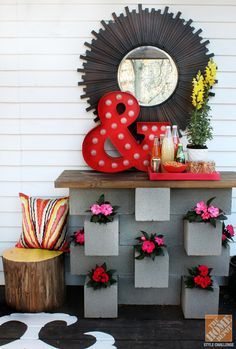 Similar to the inside of your home, focal points are important to keep in mind when designing a space. Kristin of The Hunted Interior built a console table out of concrete and brought colorful, bold accesories together to create an impactful vignette. We love the way this corner of her deck came together for her Style Challenge!