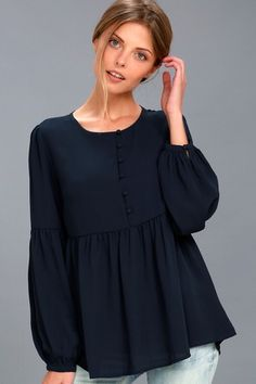 Spend the day picking poppies in the Primrose and Proper Navy Blue Long Sleeve Top! Button-up, woven blouse with bishop sleeves and a peplum hem. Frock Fashion, Hijab Fashion, Fashion Dresses, Hijab Stile, Blue Long Sleeve Tops, Mode Hijab, Muslim Fashion, Blouse Designs, Cute Dresses