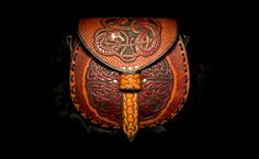 Celtic and Norse Viking Dragon Knot-Work Leather Bag by EastCoastLeather on Etsy https://www.etsy.com/listing/233371127/celtic-and-norse-viking-dragon-knot-work