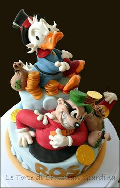Uncle Scrooge and his funny enemy. Cake topper for a hard working guy!