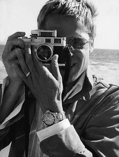 Today's über-cool celebrity with an über-cool Leica camera is BRAD PITT.