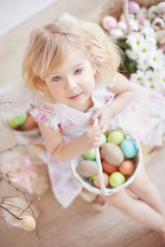 Cute Girl with Easter Egg Basket. All you need to do is snapping some cute pictures to commemorate the Easter. The lovely girl holding the Easter egg basket with charming smile is a very nice choice.