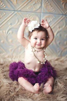 just a tutu and necklaces for this baby