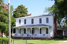 History buffs will fall in love with the circa 1844 Dawkins House, which is listed on the National Register of Historic Places. Andrew McGrath, the last confederate Governor of South Carolina, used the home's library as his temporary office during the Civil War. The stately Federal-style home features over 4,000 square feet of gorgeous historical details, including stained glass windows, a fanlight above the door, and eight (yes, eight!) fireplaces. Asking Price: $75,000 Listing Agent: Ray…