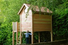 A mini treehouse with platform for younger children. This design can be accessories with additional play features as the children grow older.