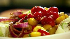 Get this all-star, easy-to-follow Quick-Marinated Cherry Tomato Salad recipe from Ree Drummond